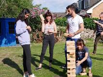Students-playing-Jenga-in-Garden